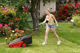 girl mowing