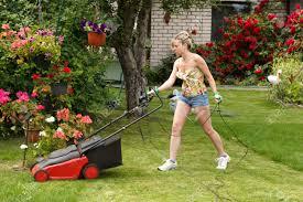 girl mowing